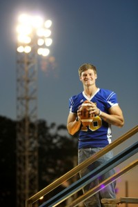 Mulerider Quarterback Tyler Sykora under the football field lights