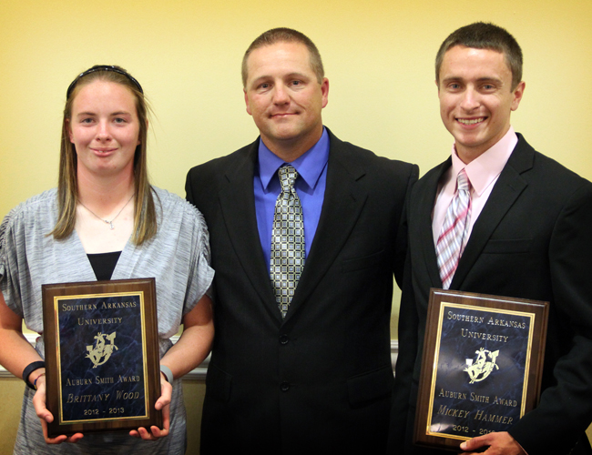 The 2013 recipients of the Auburn Smith Award were Brittany Wood, left, and Mickey Hammer, right. They are pictured with SAU Athletic Director Steve Browning.