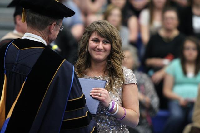 Whitley's sister accepts her diploma at graduation