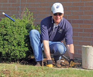 Leading by example, Dr. Rankin took part in a campus clean-up day in 2013.