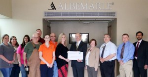 Albemarle Foundation representatives give a check for $60,000 to representatives from Southern Arkansas University for SAU engineering. Pictured, from left, are Albemarle Foundation Magnolia Council members Brinkley Jackson, Lisa Hackenberger, Kimberly Jones, Pat Hammock, Walter Hale, Sara Morris, Bob Stevens, and Lacey Fincher; and from SAU are Dr. David Rankin, Jeanie Bismark, Dr. Scott McKay, Dr. Sam Heintz, and Dr. Mahbub Ahmed.