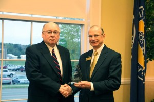 Lamar Smith, Distinguished Alumnus, receives his award from Dr. David Rankin.